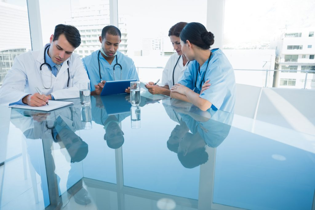 Marketing Tips: Group of young doctors in a meeting at hospital.