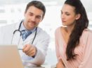 Doctor shows patient how sites like ZocDoc can prompt for patient reviews.